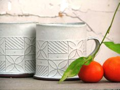 two cups with a Mandarin