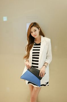 Black and white striped dress with a white overcoat.