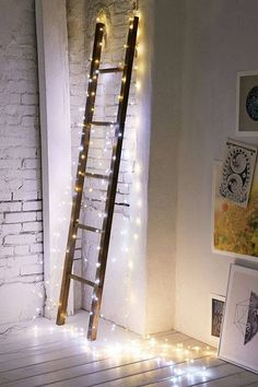 Firefly String Lights - Urban Outfitters wooden ladder fairy lights white-washed brick interior wall loft look white painted plank floors Christmas Fairy, Christmas Lights, Christmas Bedroom, Holiday Lights, Christmas Design, Light Decorations, Christmas Decorations, Christmas Ideas, Battery Powered String Lights