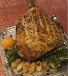 This Apricot-Glazed Ham with Madeira Sauce and Roasted Potatoes dish is one of several specialty dishes served on Holland America ships during the Holiday seas