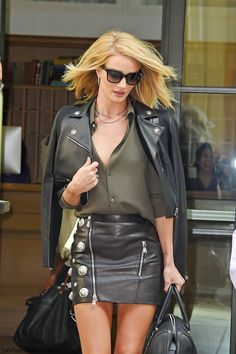 Rosie Huntington-Whiteley street style with cropped leather jacket, military shirt and leather skirt (May 2015). #rosiehuntington