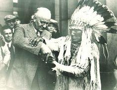1928 University of Minnesota Homecoming.  Professor Rarig learning the sign for a man riding horseback.