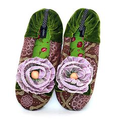 Peony Slippers (women's).  I have a pair of these from Goody in a different pattern and they are fabulous!  Thick padding and comfy, durable, and gorgeous.