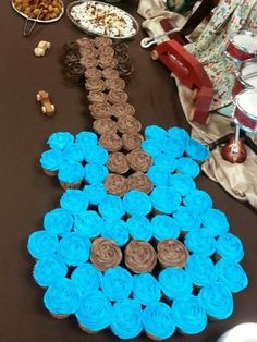 Cupcakes in the shape of a guitar