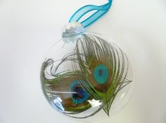 Peacock feathers in clear glass ornament.  Beautiful and simple!