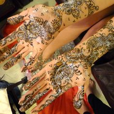 Indian tradition: Mehndi signifies the strength of love in a marriage. The darker the mehndi, the stronger the love.   Glitter was placed on top of the henna to make the henna shine and look good in the photos.