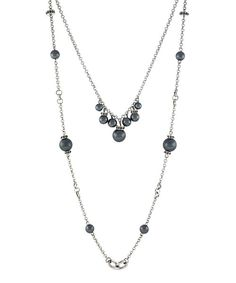 An+elegant,+ladylike+style+blossoms+from+pieces+like+this+double-strand+necklace.+A+cool,+crisp+hue+and+gleaming+metal+tones+inspire+posh+ensemble+possibilities.