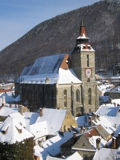 The famous Black Church of Brasov, Romania, in winter. It is the largest Gothic church in the country Cathedral Basilica, Cathedral Church, Bulgaria, Brasov Romania, Black Church, Sacred Architecture, Roman Catholic, Catholic Churches, Snow Scenes