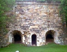 The historic Fitchburg Furnace in Ravenna, Kentucky. The furnace is a solid mass of sandstone built sixty feet high. --Not far from Winchester, Kentucky.