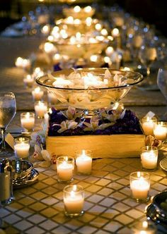 Amazing... Floating candles... Beautiful. I like the center pieces. They are elegant but not so tall that they obstruct the view.