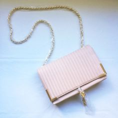 """Bebe chain cross body Gorgeous and still in wrapping Bebe crossbody in the color misty rose. 2 compartment interior. Magnetic snap closure. Measures approximately width: 11"""" , height: 7"""".  No trades and no PayPal. bebe Bags Crossbody Bags"""