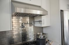 Decorations. Cozy Design Ideas Of Metal Tile Kitchen Backsplashes. Delectable Silver Color Metal Tile Kitchen Backsplash features Running Bond Shape Pattern Backsplash and White Wooden Kitchen Cabinets
