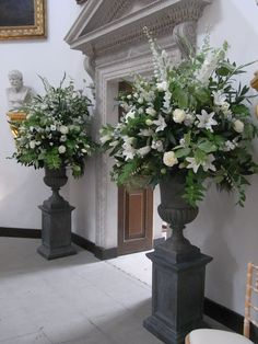 Need to find urns this size & shape- love the two pedestals, all white, with lots of greenery for weddings in our church!