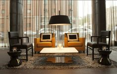 Fitzwilliam Hotel in Belfast   The black and gold color scheme of the Fitzwilliam Hotel in Belfast makes a powerful statement. Clean-lined seating and striking pillows also add an elegant flair to space, together with the floor lamp placed between the armchairs/ You can read the article 'Hospitality Design Projects: the most incredible living room ideas' at  http://livingroomideas.eu/hospitality-design-projects-incredible-living-room-ideas/