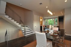 This custom home is contemporary clean! | #NewBuild #CustomHome #Stairwell #DiningRoom #Inspiration #HomeDecor