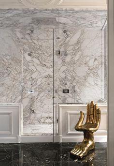 Lenny Kravitz Paris apt bathroom carrera marble glam Pedro Friedeberg hand chair