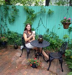duh...why didn't I think of painting my fence a pretty color??? Create a Mom's Backyard Oasis