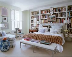 Wall of bookcases in bedroom. - love this idea, maybe for the guest room?