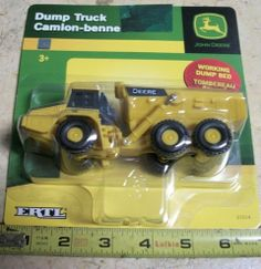 John Deere Dump Truck by Learning Curve. $12.98. 2 inhes tall. Rubber tires. 6 inches long wih real working dump bed. Body is mostly heavy plastic with a diecat metal hood.. Lots of detail. Caterpiller farm  equipment