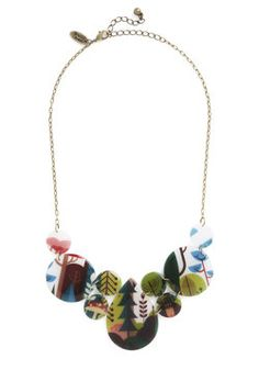 Photographic Memory Necklace in Forest>> could make something similar by wrapping shapes with magazine clippings