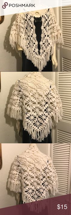 White crochet / knit boho shall with fringe Vintage boho triangular open shall cardigan. Large crochet / knit floral pattern. Fringe along bottom edge. Good vintage condition other than one spot where there is a hole, but it is lost in the pattern and not super noticeable. See photos. One size. Vintage Sweaters Shrugs & Ponchos