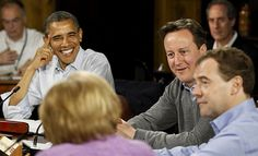 May 19, 2012 U.S. President Barack Obama (l.), Britain's Prime Minister David Cameron (2nd r.) and Russia's Prime Minister Dmitri Medvedev (r.) listen to Germany's Chancellor Angela Merkel (foreground) during the start of the first working session of the G8 Summit at Camp David, Maryland. Andrew Winning/Reuters