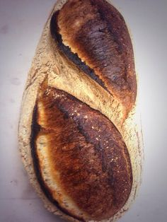 Powerful scoring on a batard. Pinned with permission of Bread Ahead Bakery ([@]BreadAhead).