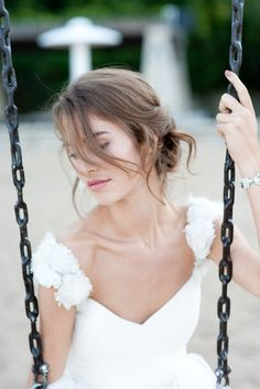 Keira Knightley style wedding hair.  Very soft & romantic.  I envision this with little pearls & flowers or some delicate jewelry piece.