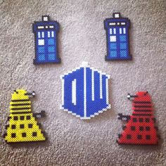 Dr. Who perler bead set, complete with logo, tardis and daleks :) Buy it here for $15.00! https://www.etsy.com/listing/178716889/set-of-dr-who-perler-bead-sprites