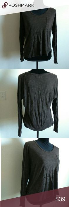 Madewell Brown Loose Long Sleeve Top Brown long sleeved Madewell Shirt. Has a high low style to it. Little slits in front, part of the design. Loose and sheer. Tag states size Medium. Used.  Measures approx 18 inches in chest and 22inches in length in the front. 100% Viscose. Madewell Tops