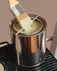 Here's a tip when painting: Wrap a rubber band over the top of the open can and down under the bottom to secure it--this way, when there is excess paint on the brush, just rub it against the rubber band instead of making a big mess on the paint can!