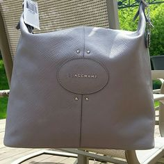Longchamp Quadri Hobo Bag Gorgeous grey (pebble) hobo style bag with 2 large interior pockets and 1 zippered interior pocket. Extremely lightweight and comfortable with shoulder detail. Color is perfect for year round use. Longchamp Bags Hobos
