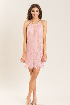 Scallops, lace, and the prettiest shade of pink! The lace up keyhole back gives this dress an extra flirty touch. We love this piece paired with strappy heels and a crystal statement necklace. It's th