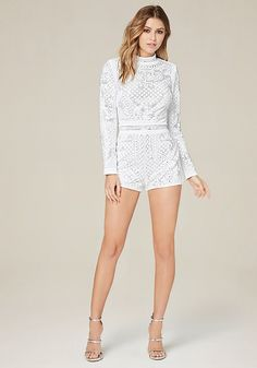 Glam little romper covered in shimmering, artfully arranged iridescent studs. Shoulder pads create a strong silhouette. Mock neck. Long sleeves. Hidden back hook-and-eye and zip closure. Partially lined.