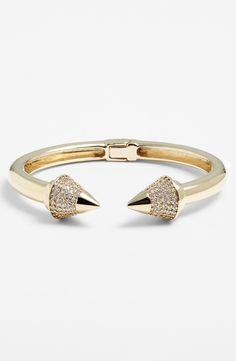 Loving this chic and edgy gold spike cuff bracelet.