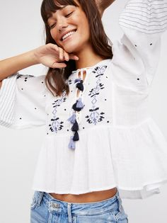 Embroidered Crop Top | Sheer, gauzy top with a subtle cropped fit featuring beautiful embroidery throughout with front and back lace-up designs. * Flared sleeves * Swingy shape