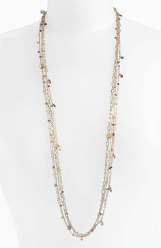 Just bought this and love it -- goes with everything!    NuNu Designs Multistrand Long Station Necklace | Nordstrom