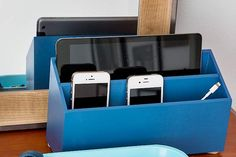 Create a neat place to power up phones and tablets. Make one, as we did, by drilling holes in the bottom of a wood mail sorter, to thread cords through, then give it a coat of color. | Photo: Burcu Avsar