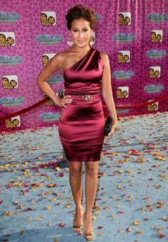 "Actress Adrienne Bailon arrives at the premiere of Disney Channel`s ""The Cheetah Girls One World"" held at the El Capitan Theater on August 12, 2008 in Hollywood, California."