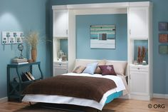Queen size wall bed with twin side cabinets.  Arctic white with bead board doors.  From Organized Hawaii.