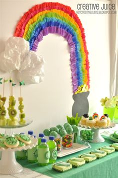 St. Patricks Day Party decor ideas and food! Love the crepe paper rainbow!