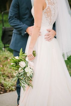 Sheer lace button up sleeveless wedding dress: http://www.stylemepretty.com/california-weddings/winters-california/2016/08/17/this-sunset-wedding-is-take-your-breath-away-beautiful/ Photography: Retrospect Images - http://weddings.retrospectimages.com/home/