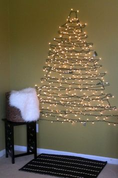 DIY CHRISTMAS TREE ALTERNATIVE: I saw one of these recently with color lights and it was beautiful!