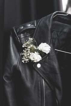 Leather and flowers=hard and soft. Image via TheyAllHateUs
