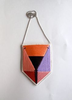Embroidered pendant necklace with colorblock by AnAstridEndeavor