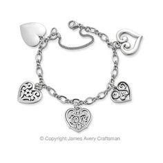 Five Distinct Hearts Arranged Along A Linked Chain Symbolizing Commitment Love And Desire Highlight This Lovely Charm Bracelet