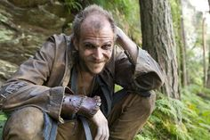 Boat builder and jokester Floki (Gustaf Skarsgard). Says History: Floki is based partly on the Norse god Loki, is an impish character and ship builder who designs and builds the prototype of the new generation of Viking ships which can sail across the open ocean but also up the shallowest of rivers. He is a design genius and he allows Ragnar to fulfill his dreams of sailing west and discovering new lands and new civilizations.