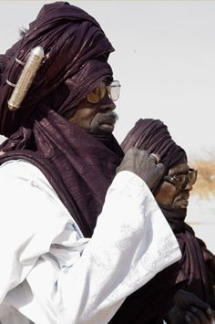 "Africa | The cylindrical box attached to the turban is a talisman, containing verses from the Koran. ""Bianou 2004"". Agadez, Niger 