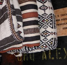 Vintage Saharan wool blankets (from Mali and Burkina Faso) on a colonial camel trunk. adireafricantextiles.com