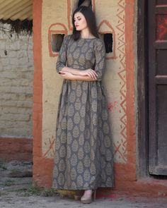 Shop online Grey side pleated maxi Showcasing an all-over print and side pleats, this grey maxi with boat neck and quarter sleeves is high on urban style and new-era trends Simple Kurti Designs, Kurta Designs Women, Indian Fashion Designers, Indian Designer Outfits, One Piece Frock, One Piece Dress Design, Indian Gowns Dresses, Pink Dresses, Pakistani Dresses